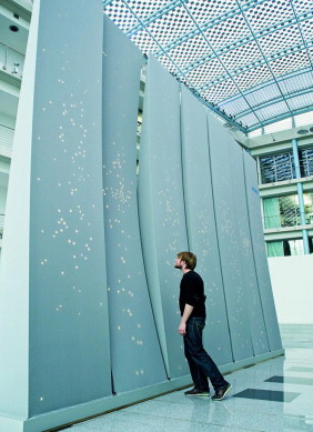 The skin of each InteractiveWall covered by a unique, irregular distribution of ...