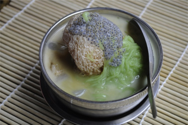 Nyonya chendol. A mixture of crushed ice, coconut milk, palm sugar, ...